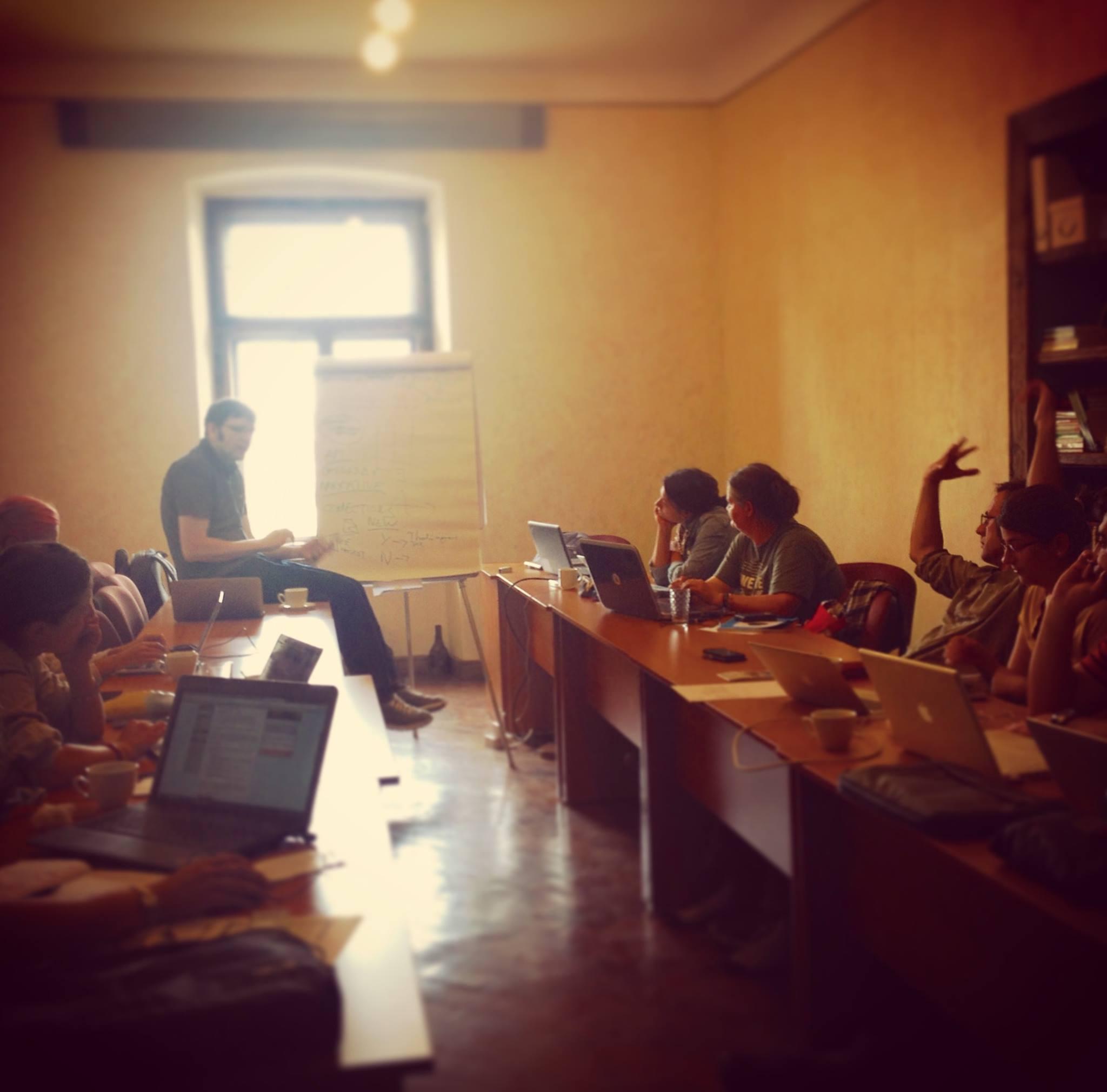 Glyn Thomas giving a presentation in Cluj, Romania